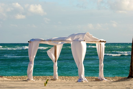 trees services: Beach wedding archway Stock Photo
