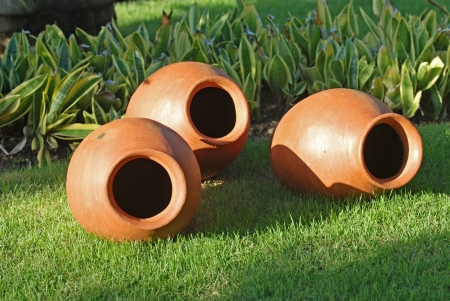Clay pots on grass photo