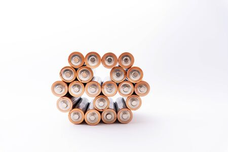 Top view at the plus batteries standing in figure. Isolated.