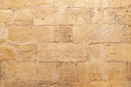 Brick brown wall background, ancient style and sand.