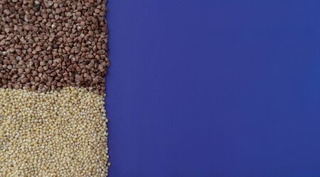 Purple background with brown fried buchwheat and yellow millet, donation concept during quarantine, cereal concept, copy space,