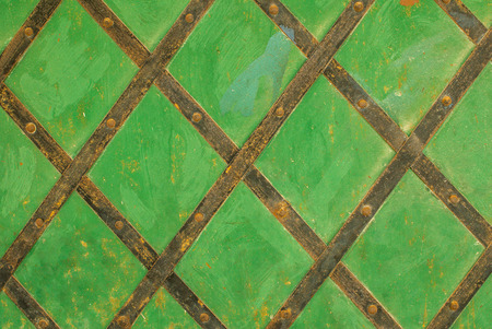 pitting: iron surface is covered with old paint background