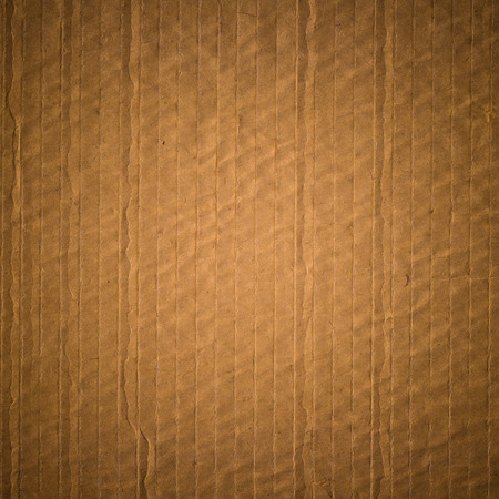 corrugation: old recycled dark sepia color corrugation paper texture background