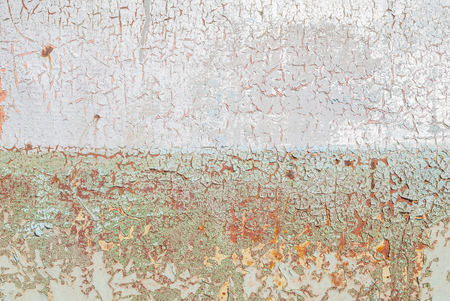 pitting: old surface of the metal sheet covered with old paint, texture background