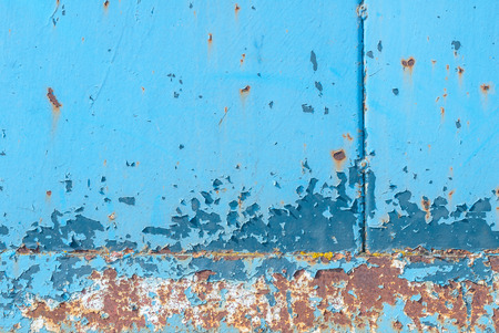 surface of rusty iron with remnants of old paint, chipped paint, texture background Stock Photo