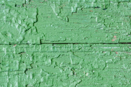 worn: texture of wooden surface with remnants of old paint that has dried and cracked under the influence of weather