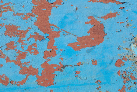 iron surface is covered with old paint, chipped paint, texture background Stock Photo
