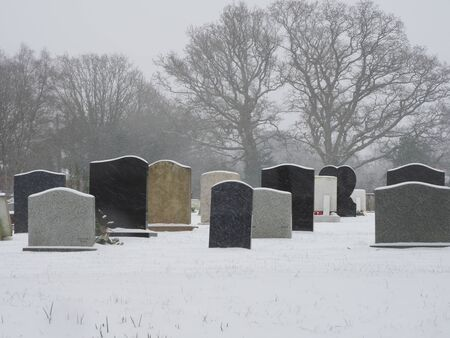 a cemetry in the snow
