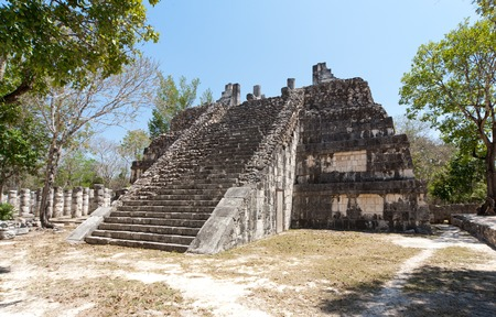 Building of Mayan origin rises out of the jungle at Chichen Itza. Stock Photo