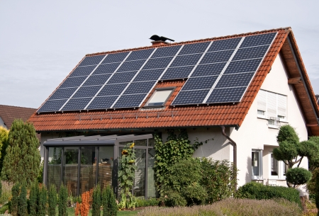 flat roof: rural residence with solar panels on a roof  Stock Photo