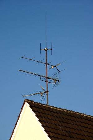 house gables: House with antennas Stock Photo