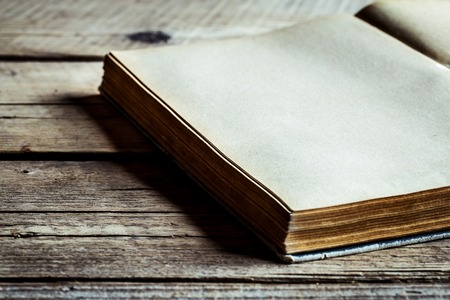 format: Book on wooden background, reading, old book, secret book, one book