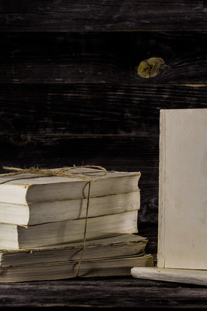 thesaurus: stacked books on a wooden background, place for text Stock Photo
