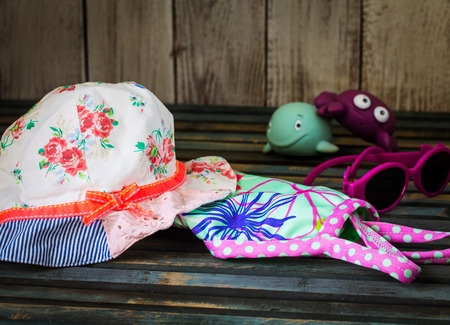 baby stuff: baby stuff to the beach on a beautiful wooden background