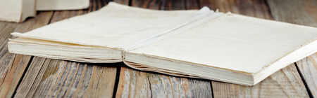 white old books on the background of wooden boards, there is a place for text Banco de Imagens