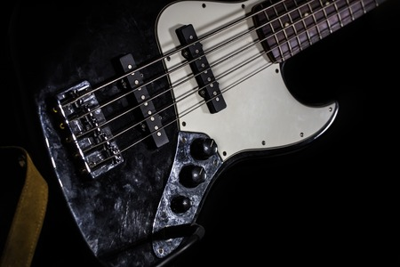 hardrock: bass guitar, musical instrument on black background