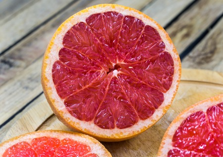 freshest: cut grapefruit on a wooden Board, citrus on wooden background