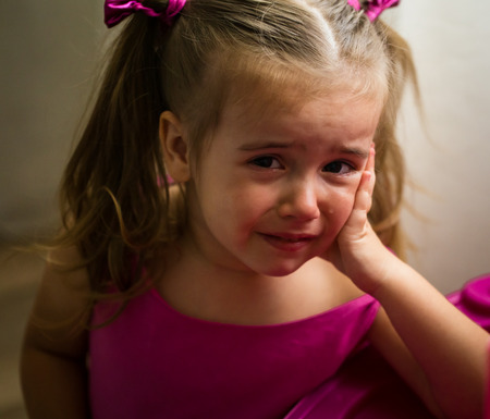 cries: a beautiful little girl, showing emotions, crying offended Stock Photo