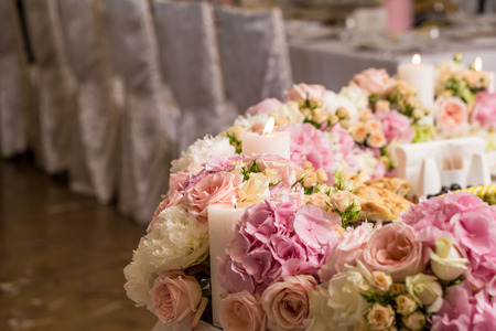 Wedding decor,flowers and candles decorated the table chairs beauty