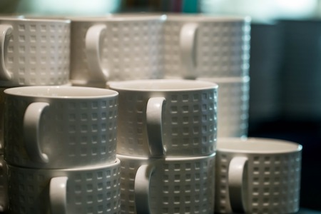 neatly stacked: neatly stacked white cups for the bar and restaurant, Close up Stock Photo