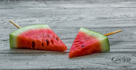 Delicious watermelon on a wooden background.