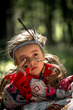 beautiful little girl playing outdoors in Indian portrait,emotion Stock Photo