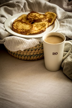 delicious Breakfast in bed with a big sword coffee, food