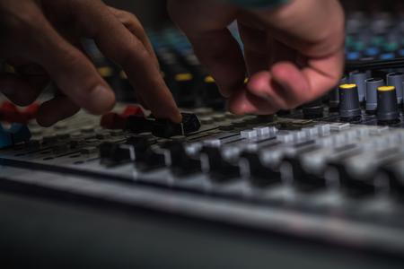 digital volume: fader digital mixing console with volume meter, volume indicator, closeup