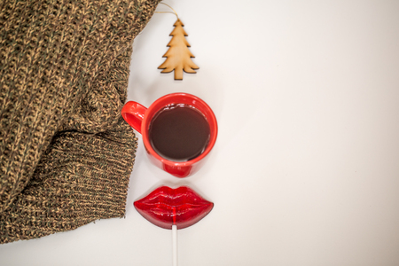 red cup of hot drink on white background with christmas items stock photo 63576893