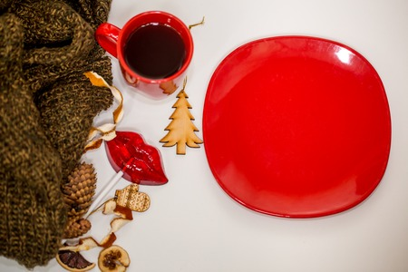 red Cup of hot drink on white background with Christmas items