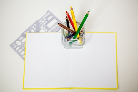 all for children creativity, pencils, scissors, colored paper, there is a place for text Stock Photo
