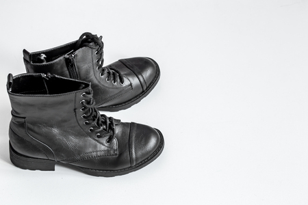 steel toe boots: black high boots on a white background