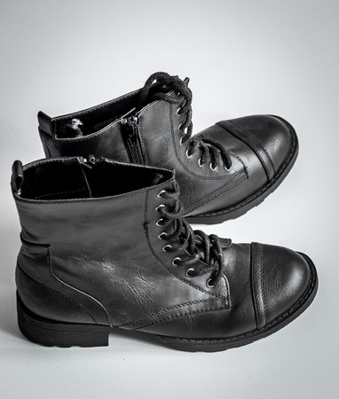 skinhead: black high boots on a white background