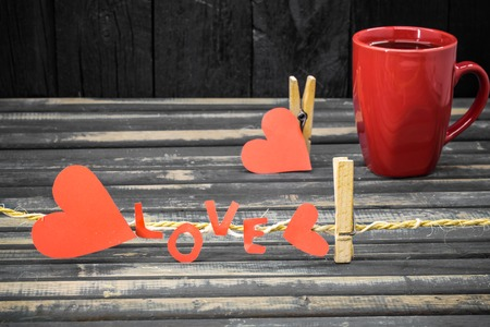 word love made of paper and red Cup on wooden background love Concept