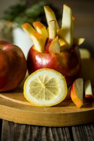 honey tone: Still life with apples on wooden background . Apples cut into strips.