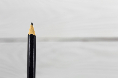A simple pencil on white background ,closeup,macro