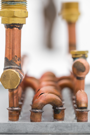 water frozen: burst copper pipes from the cold, closeup Stock Photo
