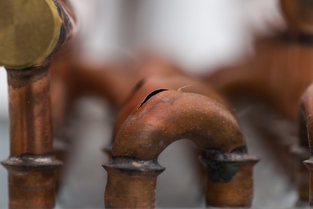crack pipe: burst copper pipes from the cold, closeup Stock Photo