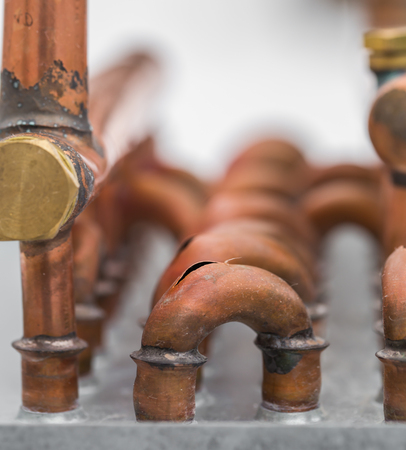 burst copper pipes from the cold, closeup Stock Photo