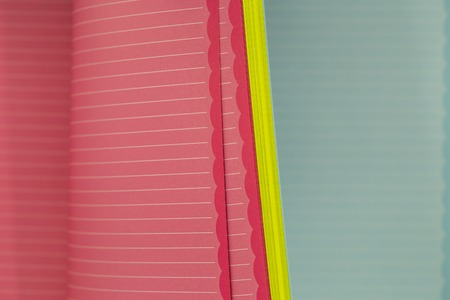 memo pad: color memo pad with spring paper with horizontal stripes, closeup