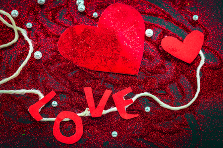 burnish: heart of sequins on a black background Valentine day concept holidays