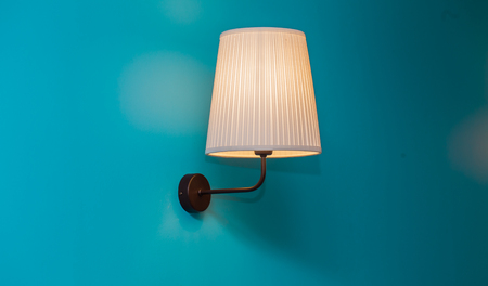 wall sconce: beautiful vintage lamp on the blue wall Stock Photo