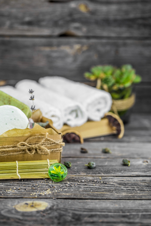 SPA still life of tools to massage and bath on wooden background