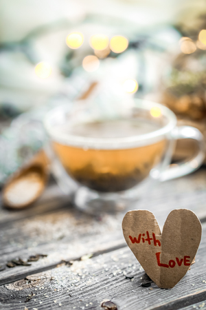 Valentines day still life with tea and a heart on wooden background Stock Photo