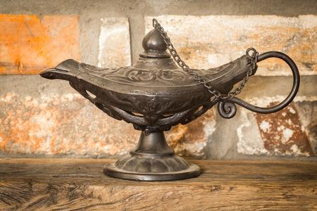 Beautiful vintage Aladdin lamp on the rocky background