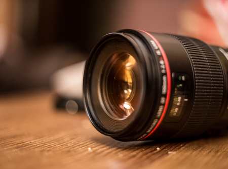 lens for the camera closeup on wooden background