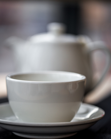 daily life: white tea Cup closeup at the table in a cafe,the concept of Breakfast and tea