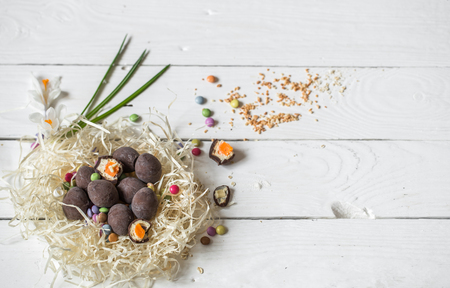 Ingredients Easter and chocolate eggs on white wooden table,holiday concept and preparation Stock Photo