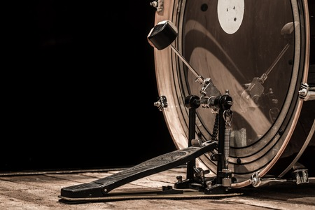 percussion instrument, bass drum with pedal on wooden boards with a black background, the music concept Banque d'images