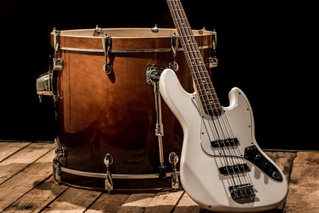 musical instruments, drum bass Bochka bass guitar on a black background, the music concept